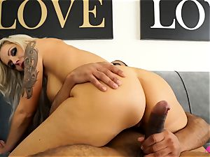 huge-titted platinum-blonde Nina Elle taking a meaty black bone