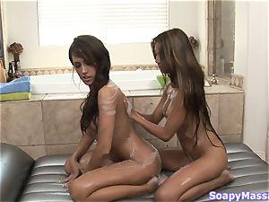 Pretty chicks Kina Kai and Capri Cavanni rubbin' one another