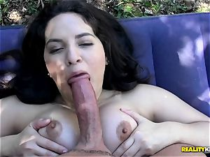 Amy Lopez inhales his fat pink cigar in the backyard before she lets him poke her