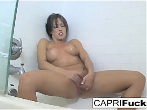 Capri enjoys to finger her cock-squeezing cooter
