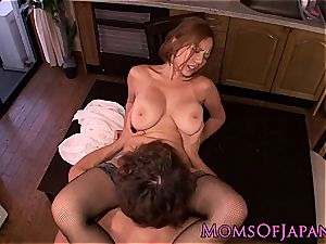 asian mother in stockings glides pink cigar in her cell