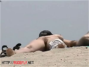 huge-boobed naked beach stunners filmed by a spycam